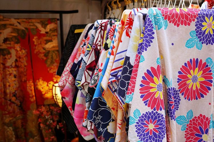 Close-up of multi colored textiles hanging for sale in store