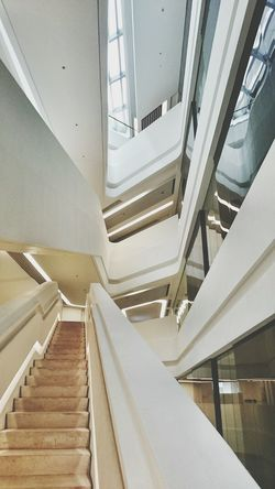 Zaha Hadid HongKong Architecture Interior Design Stairs Curves And Lines Organic Polytechnic Innovation Tower Yellow White Jockey Club