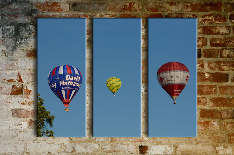 balloons on the wall Artistic Twist Balloons Blue Brick Wall Clear Sky Day Flying Geometric Shape High Section Hot Air Balloons Low Angle View Multi Colored No People Outdoors Typtrich Of Hot Air Balloons Wall Art Yellow