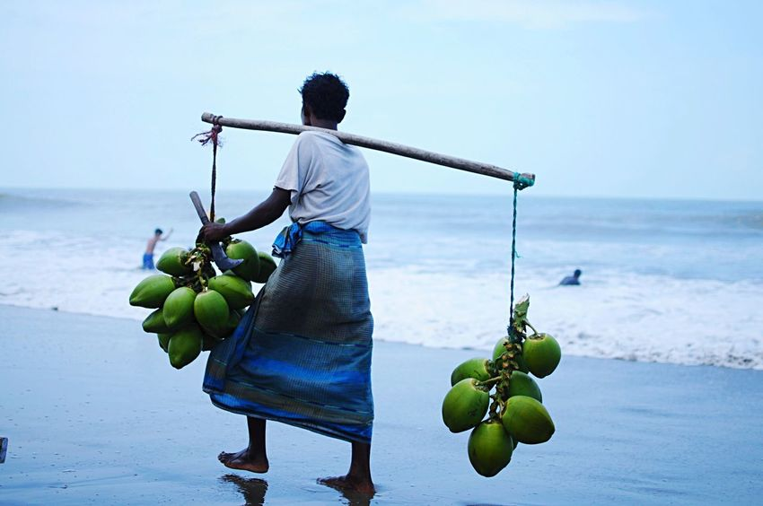 Life In The Beach Lifestyles Daily Life Working Hard Vendor Coconut Coconut Seller Summer Stranger Travel Photography Traveling Hello World Cox's Bazar, Bangladesh Cox's Bazar Small Business Heroes