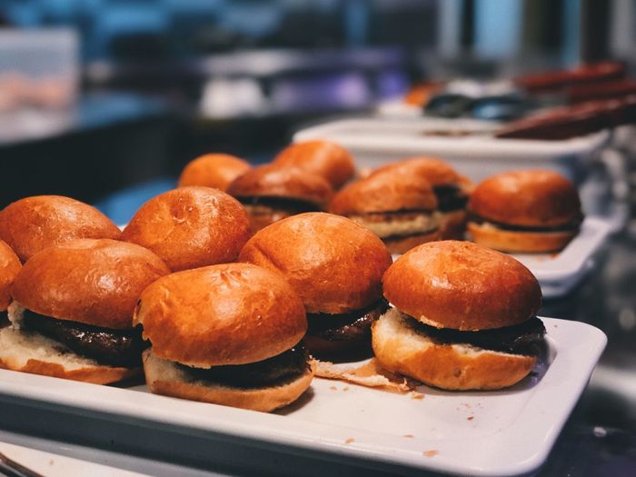 Close-up of burgers in plate on table