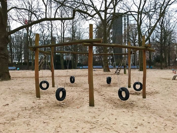 Winter playground Winter Swings Playground Outdoor Play Equipment Tree Park - Man Made Space Bare Tree Childhood Jungle Gym Day Swing Built Structure Outdoors No People