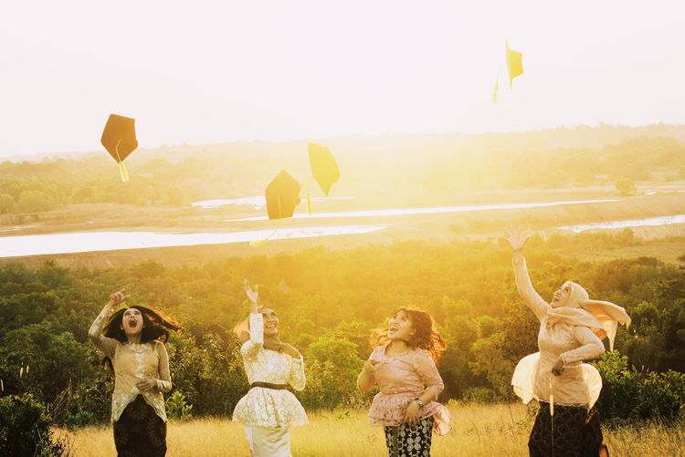 Happy Graduate Happiness Happy Happy People Mood EyeEm Nature Lover EyeEm Selects Women Guardian Warm Colors Warm Light Warm Sunlight Sunshine Backlight Tree Togetherness Sky Sunbeam Friend Sunset Lens Flare Orange Color Shining International Women's Day 2019