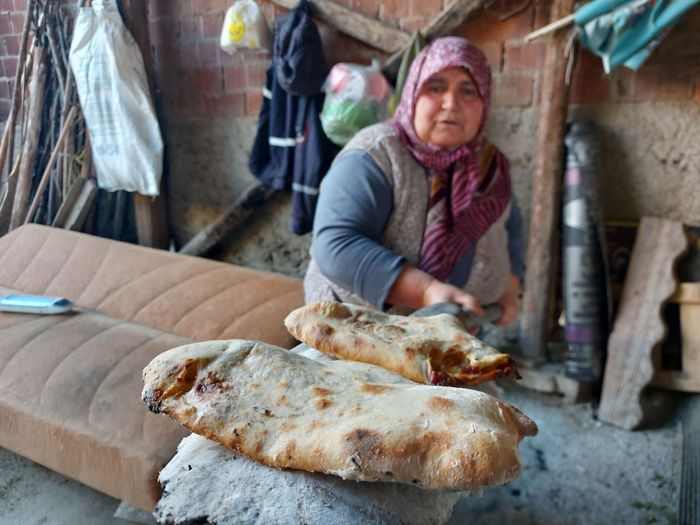 Young man preparing food at market stall