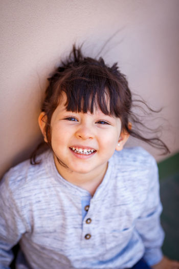 Smiling Portrait Child Happiness Childhood Emotion Looking At Camera One Person Teeth Toothy Smile Headshot Cheerful Casual Clothing Front View Offspring Hairstyle Girls Innocence Bangs Children Photography Children Only