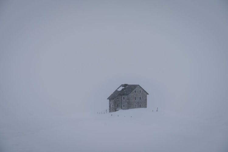 House against sky during winter