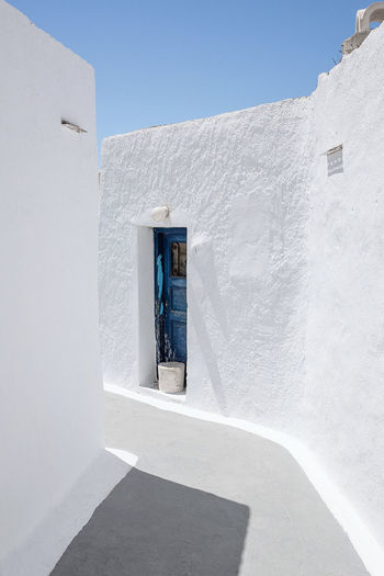 White door of building against clear sky