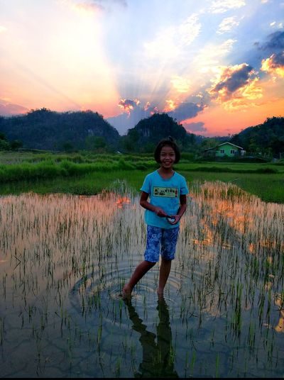 Reflection One Person Water Nature Child Front View Rice Paddy Thailand🇹🇭 2018 Outdoors Beauty In Nature Growth Sunset People Portrait Smiling Children Only Girls Sky Looking At Camera Standing Tranquility Woman Tree Scenics EyeEmNewHere
