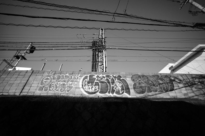 TaggedWalls Blackandwhite Monochrome Leica M9-p Voigtlander Lens Super Wide Angle Super Wide Heliar 15mm F4.5 Street Walk Communication Guidance Close-up Street Scene Power Supply Telephone Line Electricity  Telephone Pole Power Line  Electricity Pylon Electricity Tower Cable Electric Pole Power Cable