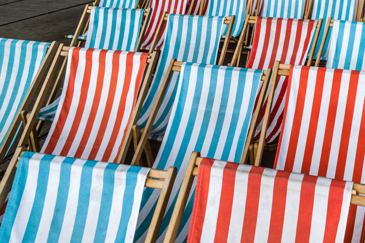 Beach Chairs Striped Retail  Multi Colored Outdoors No People Market Consumerism Choice Summer Blue Day Awning Close-up