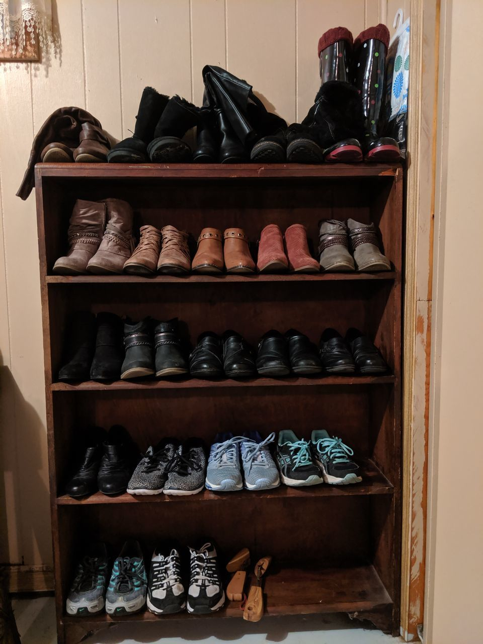 shelf, choice, rack, variation, indoors, large group of objects, order, shoe, in a row, arrangement, closet, no people, storage compartment, collection, abundance, still life, pair, home interior, clothing, furniture, cabinet