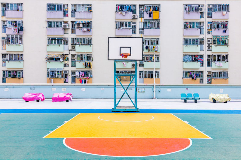 Basketball Hoop Against Buildings In City