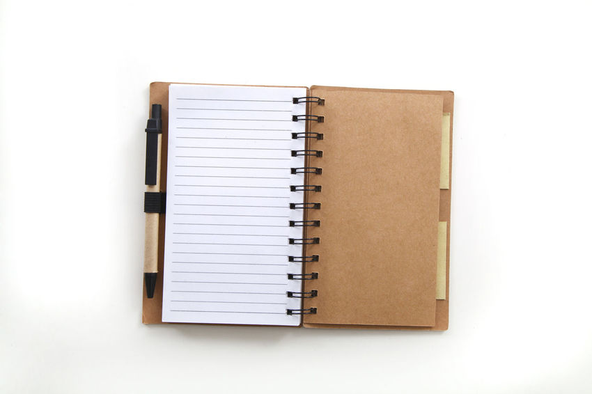 open spiral notebook with raws paper and a pen EyeEmNewHere Blank Book Close-up Copy Space Cut Out Day Diary Education Indoors  No People Note Pad Open Page Paper Ring Binder Spiral Notebook Studio Shot White Background Writing