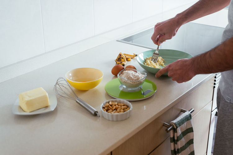 Midsection of man having food at home
