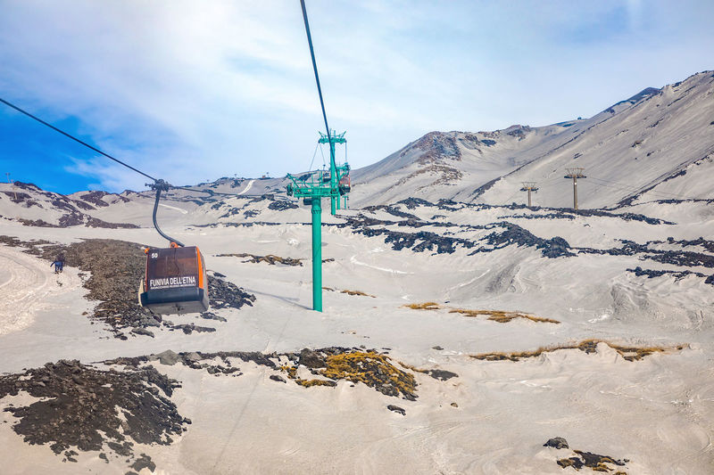 Etna Volcano Sicilia Italy Sicily Winter Snow Cold Temperature Mountain Sky Cable Cable Car Scenics - Nature Beauty In Nature Nature Ski Lift Cloud - Sky Day Transportation Mountain Range Landscape Tranquility Tranquil Scene Overhead Cable Car Snowcapped Mountain No People Electricity  Outdoors