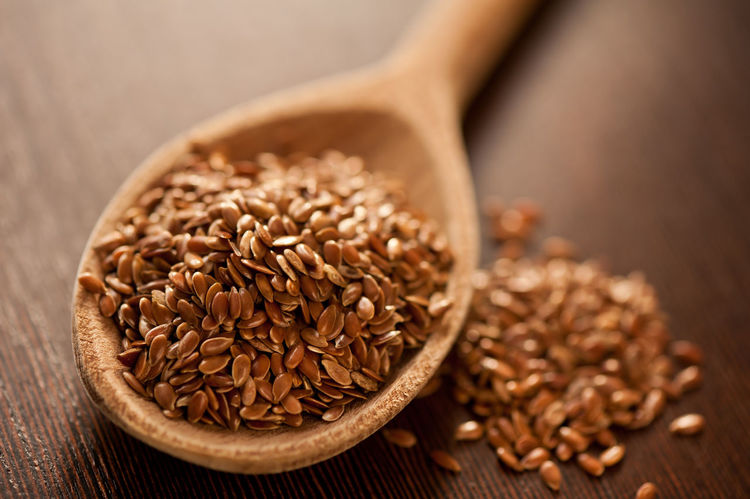 Brown flax seeds heap on wooden spoon closeup, healthy raw seeds portion in day light, horizontal orientation, nobody. Brown Close-up Closeup Culinary Flax Flaxseeds Food Grain Grains Heap Kernel Linseed Linseeds Linum No People Portion Seed Seed Seeds Spoon Usitatissimum Wooden