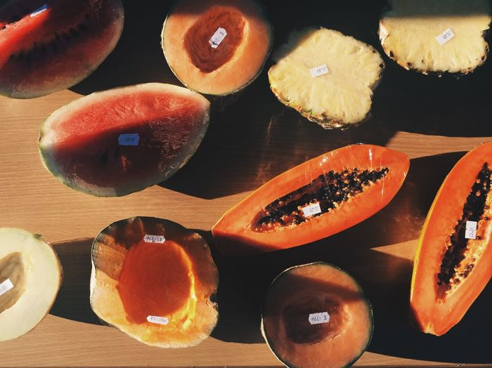 Fruit for sale in the winter sun. Food And Drink Food Fruit Healthy Eating SLICE Freshness Table Indoors  Halved Melon Pineapple Day Mango Halves For Sale Fresh Fruit Winter Sun Contrast Shadows