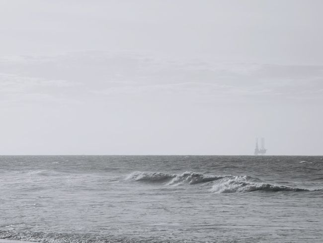 Oil rigs in the middle of ocean of Brunei. Brunei Oil Rig Backgrounds Petroleum Rigs Wave Black And White Ocean Sea Sea Life No People Horizon Over Water Water Sky Day Cloud - Sky Nature