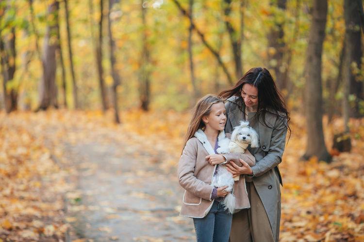 Couple holding autumn tree