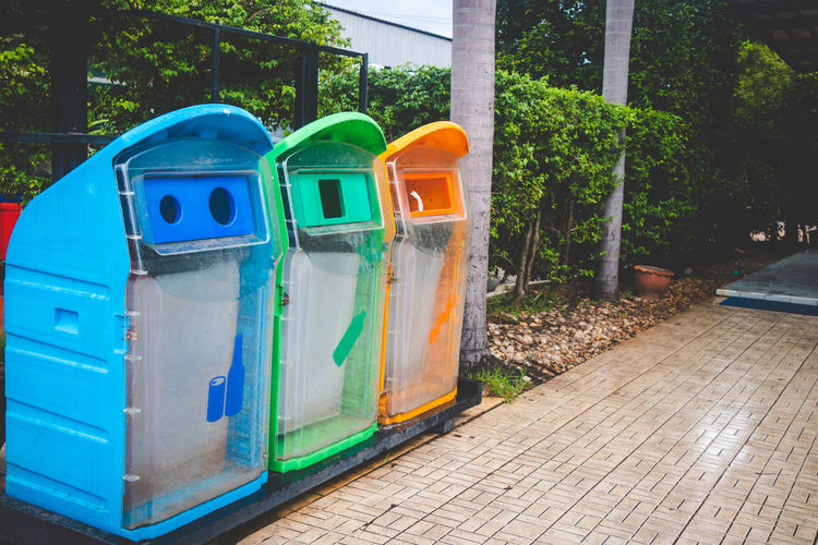 Colorful Garbage Cans On Footpath In City