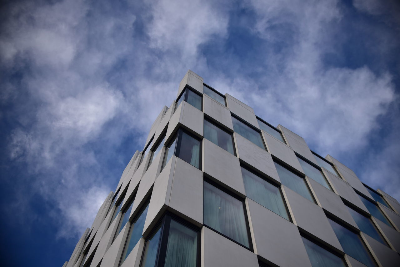 building exterior, architecture, sky, low angle view, built structure, modern, cloud - sky, window, day, no people, outdoors, futuristic