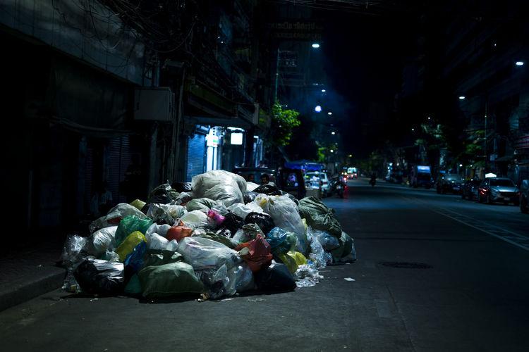 Garbage on street at night