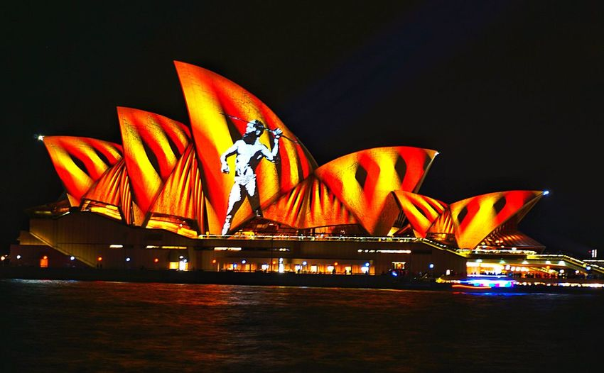 The Sydney Opera House lit up for Vivid an annual display of Light and Music This year, the sails took on an Indigenous  theme. Loved everything about it too! Aboriginal Aboriginal Art Aborigines Sail Harbour Sydney Australia New South Wales