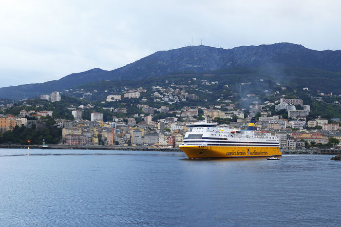 Annamour Architecture Building Exterior Built Structure Cityscape Corse Corsica Ferry Landscape Mode Of Transport Mountain Nature Nautical Vessel No People Outdoors Sea Sky Sunset Transportation Travel Destinations Vessel Water Waterfront