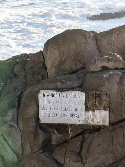Close-up of text on rock