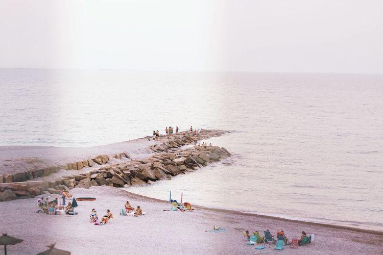 seaside in the summer EyeEm Selects Water Sea Beach Sand Summer Full Length Swimming Sky Horizon Over Water Sunbathing Wave Shore Bikini Seascape Coastline Beach Holiday Pebble Beach