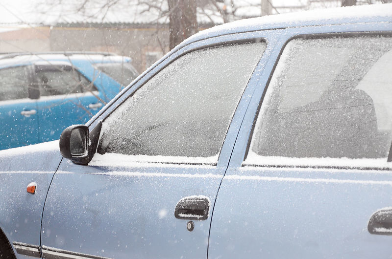 Close-up of snow on car