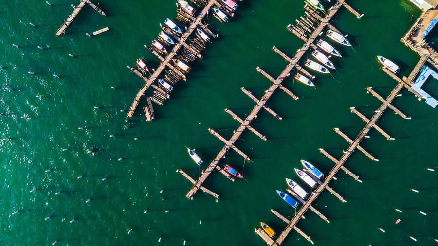 Water High Angle View Waterfront Nautical Vessel Transportation Day No People Nature Mode Of Transportation Sea Green Color Moored Outdoors Wood - Material Large Group Of Objects Group Of Animals In A Row Pattaya