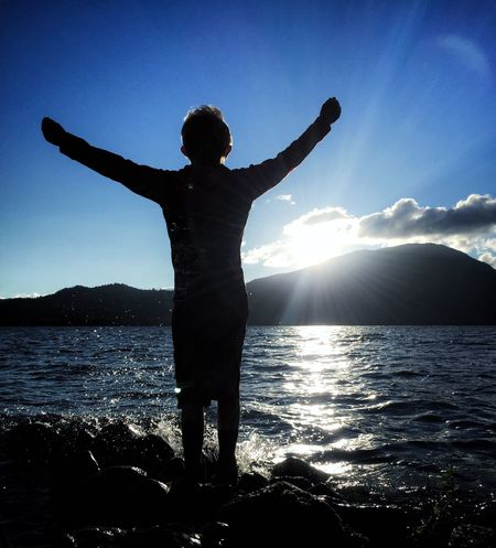 My Son ❤ Silhouette Standing Water Mountain Tranquility Tranquil Scene Scenics Non-urban Scene Leisure Activity Idyllic Lifestyles Vacations Nature Relaxation Sunbeam Beauty In Nature Sea Mountain Range Blue Sunny People And Places