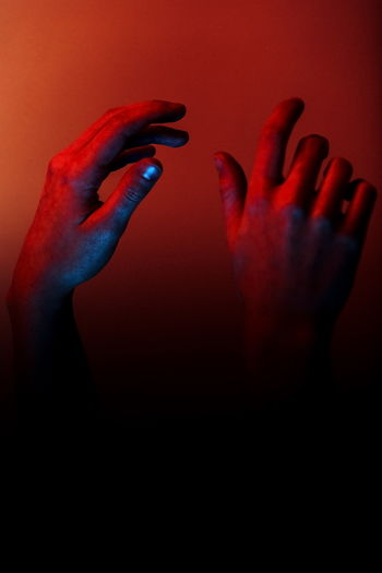 Close-up of human hand holding red text