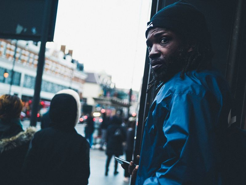 Making the call. Londonlife Streetphotography London Brixton Portrait Well Turned Out
