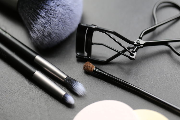 Black Color High Angle View Indoors  Close-up Still Life Table Beauty Product Headphones Make-up Brush Personal Accessory Group Of Objects Choice Make-up No People Selective Focus Variation Simplicity Glasses Art And Craft Fashion