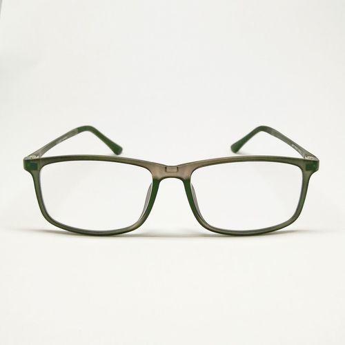 Close-up of eyeglasses on glass against white background