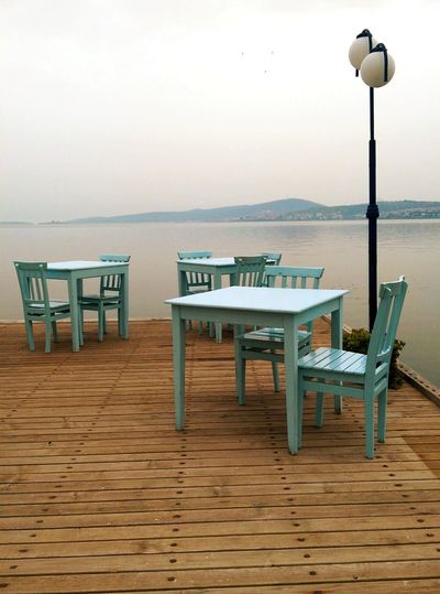 Table Chair No People Sea Empty Water Day Nature Sky Outdoors