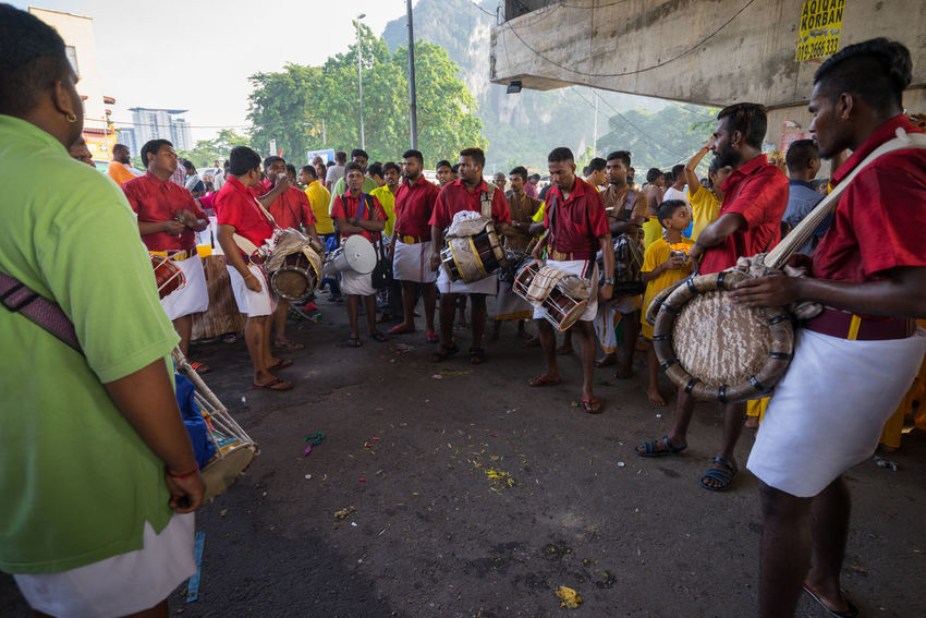 BATU CAVES, MALAYSIA - 9TH FEBRUARY 2017; Hindu devotees performing a pray session during Thaipusam festival in Batu Caves temple, celebrating Lord Murugan victory over the demon Soorapadman. Adult Adults Only Batu Caves -Malaysia Day Hindu Temple Large Group Of People Men Musical Instrument Musician Outdoors Participant People Performance Group Thaipusam 2017 Women