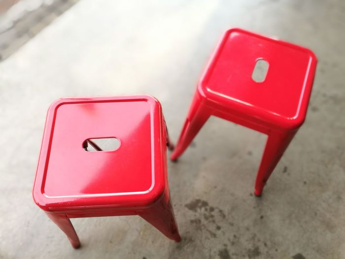 High Angle View Of Red Stools