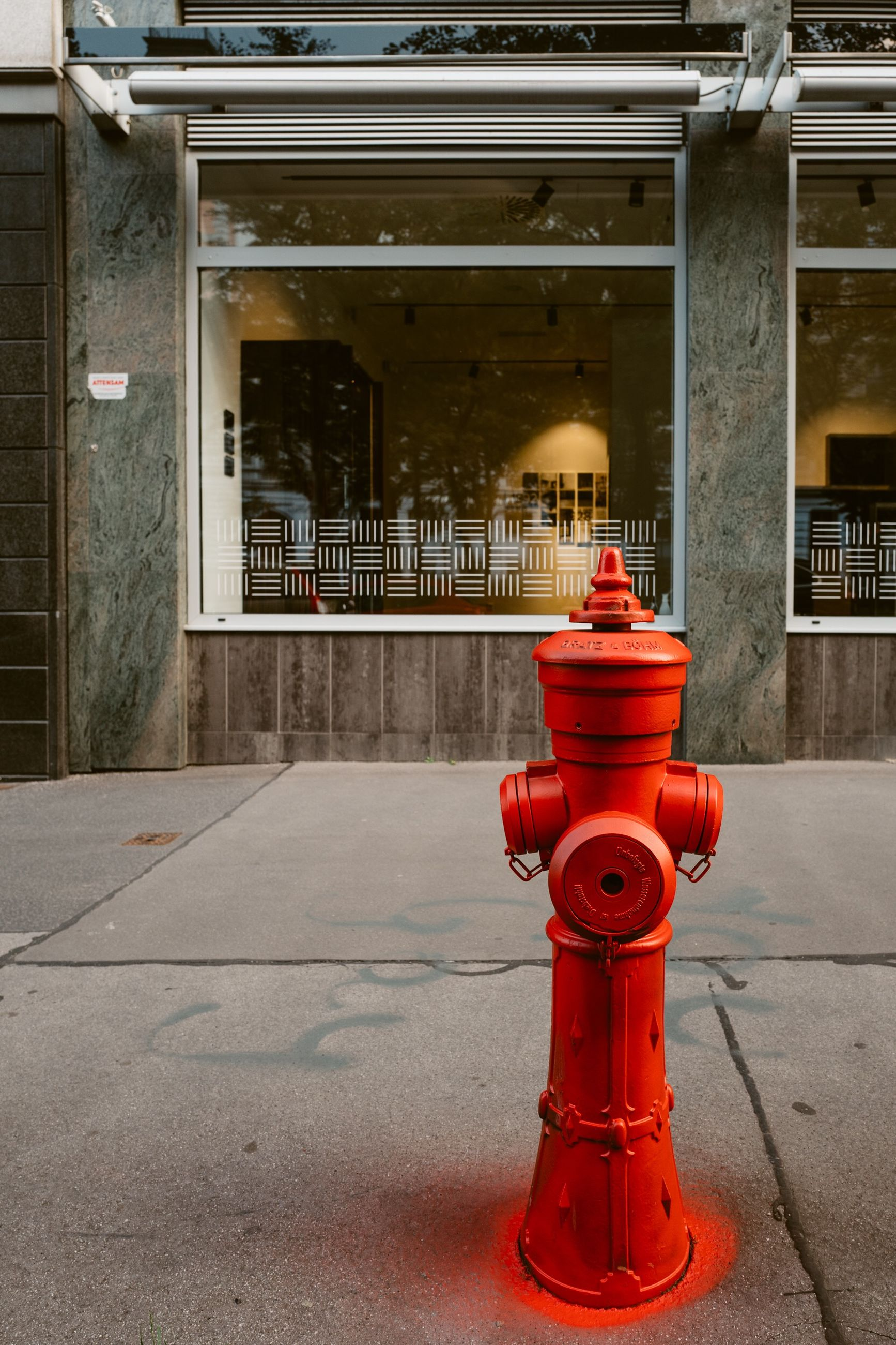 red, safety, architecture, fire hydrant, security, building exterior, protection, built structure, accidents and disasters, no people, footpath, city, day, sidewalk, street, outdoors, emergency equipment, building, water, metal