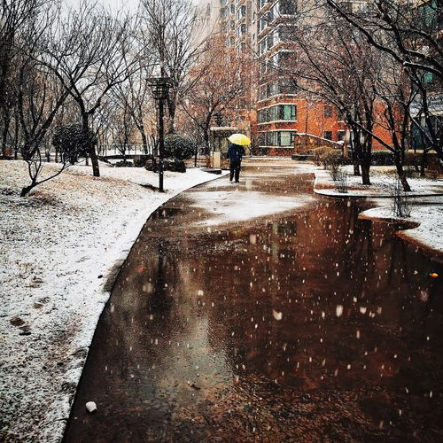 Man on wet road during winter