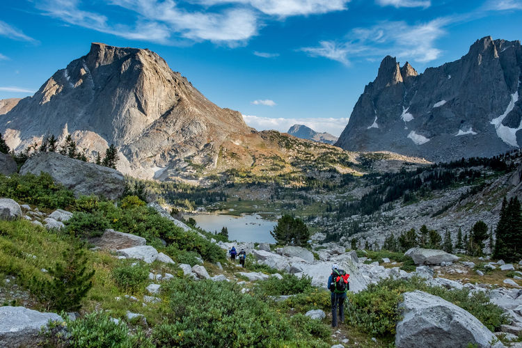 Hiking in the Wind River Range, Wyoming. Hiker Hike Outdoor Women Wilderness Adventure Wilderness Adversity Wyoming Adventure Wyoming Landscape Wyoming Women Adventurers Strong Girl Girl Courage Woman Who Inspire You Woman Sunset Backpack Backpacking Hiking Outdoors Mountain Peak Real People Mountain Range Mountain FUJIFILM X-T2