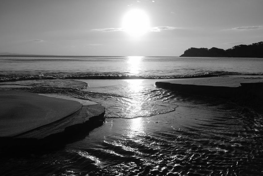 Water Sea Beauty In Nature Scenics Nature Tranquility Tranquil Scene Sun Sunset Sky Outdoors No People Beach Day Horizon Over Water Sunlight Reflection