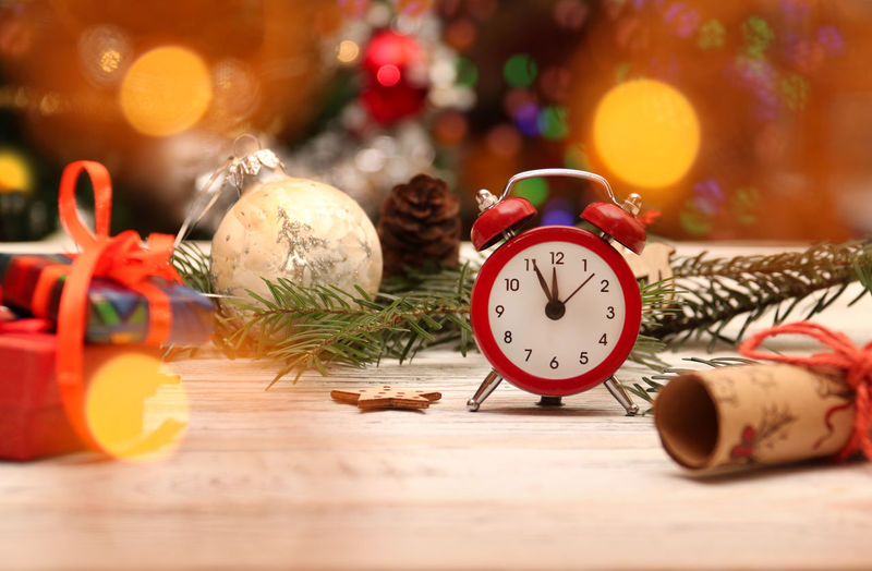 midnight soon happy new year time clock Celebration Christmas decoration Holiday christmas decoration alarm clock table christmas ornament selective focus indoors wood - material still life holiday - Winter Season Copy Space Happy New Year Time Clock Celebration Christmas Decoration Holiday Christmas Decoration Alarm Clock Table Christmas Ornament Selective Focus Indoors  Wood - Material Still Life Holiday - Event Clock Face New Year's Eve Minute Hand Midnightmemories Midnight New Year's Day 12 O'clock December