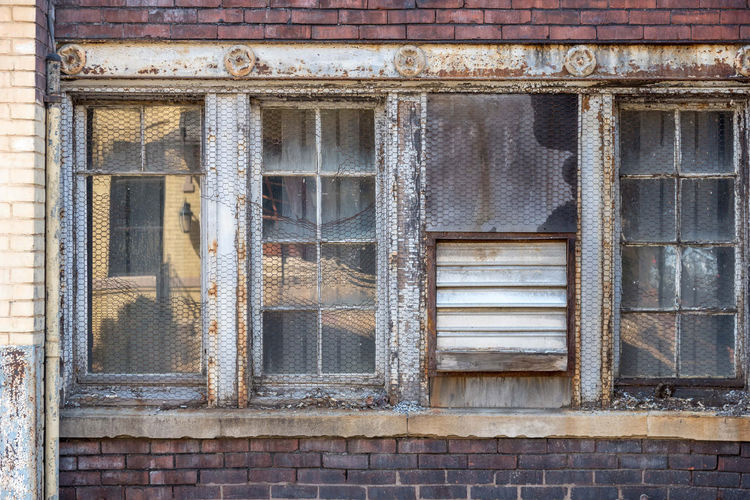 Close-up of window of abandoned building