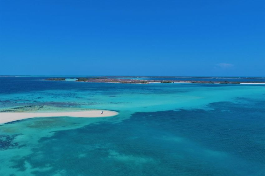 Aerial view of island and beach in Los Roques, Venezuela Water Sea Scenics - Nature Blue Beauty In Nature Tranquil Scene Sky Tranquility Nature Land Day Beach No People Clear Sky Idyllic Copy Space Island Horizon Over Water Horizon Outdoors Turquoise Colored Shallow Los Roques Madrisqui Caribe Caribbean Caribbean Life Caribbean Island Francisqui Crasqui Carenero's Beach Cayo De Agua Venezuela