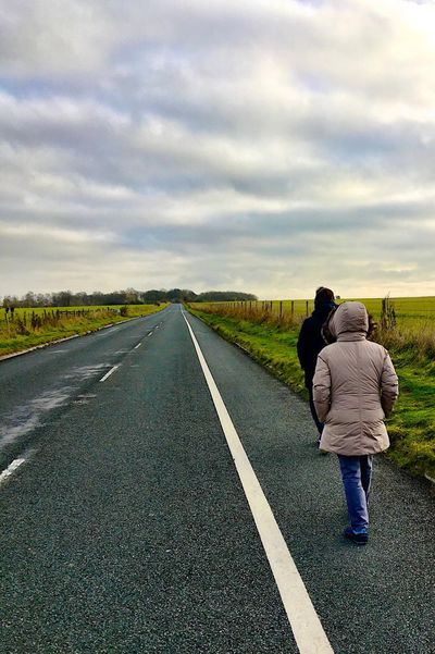 A long way to walk to Stonehenge. Cloud - Sky Rear View Full Length Sky Road Real People Women The Way Forward Grass Beauty In Nature EyeEmNewHere IPhone Bring Me The Horizon The Great Outdoors - 2017 EyeEm Awards Wonder Of The World
