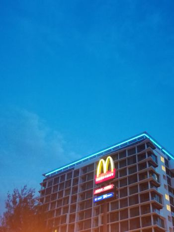 Huawei Huaweidesign HuaweiP10Lite Huaweip10litephotography Malaysia Malaysiaphotography Mcdonalds Mcd Building Exterior Neon Architecture Illuminated Multi Colored Built Structure Outdoors No People Day Clear Sky City Sky