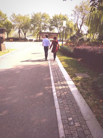 Two People Walking Togetherness Tree People Adult Outdoors Day Rear View Real People Men Adults Only Nature Sky